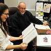 Lincoln Academy senior, Kali Jones, works with teacher Kent Chesser on the annual appreciation night program Tuesday May 10, 2016. (Billy Hefton / Enid News & Eagle)