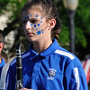 A painted member of the Fargo High School band as they march in the Tri-State parade Friday May 6, 2016 in downtown Enid. (Billy Hefton / Enid News & Eagle)