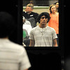 Lincoln Academy senior, Brandon Ballin and all the seniors see their reflection in a mirror as file toward their seats during Lincoln Academy Senior Appreciation Night Tuesday May 17, 2016. (Billy Hefton / Enid News & Eagle)