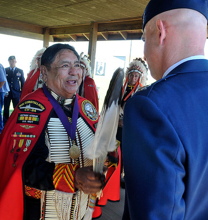 Tugger Palmer, of the Kiowa Black Leggins Society, blesses Col. Clark Quinn during the Woodring Wall of Honor Memorial Day service Monday May 30, 2016. (Billy Hefton / Enid News & Eagle)