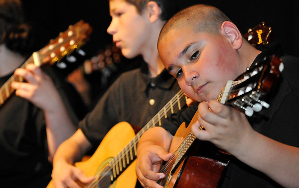 Junior E. Campos, from Longfellow Middle School, performs during the Lead Guitar Enid of Year Concert Monday May 2, 2016 at Emerson Middle School. (Billy Hefton / Enid News & Eagle)