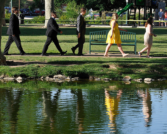 Enid High School seniors make their way around Government Springs Park during the 101st May Fete Tuesday May 10, 2016. (Billy Hefton / Enid News & Eagle)