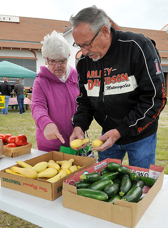 Pery and Wanda Blackshear shop for some squash during the opening day of the Enid Farmers' Market Saturday May 14, 2016. (Billy Hefton / Enid News & Eagle)