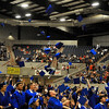 Enid HIgh seniors toss their caps into the air at the end of the graduation ceremony Tuesday May 24, 2016 at the Chisholm Trail Expo Center. (Billy Hefton / Enid News & Eagle)