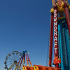 Rides and booths of the Ottaway Amusement Co. are set up in the Oakwood Mall parking lot Tuesday May 2, 2017. (Billy Hefton / Enid News & Eagle)