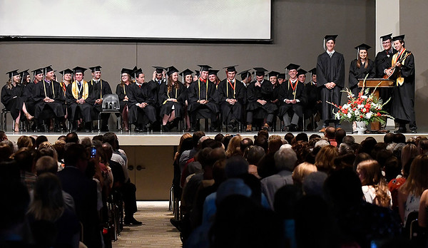 A quartet of seniors perform during commencement exercises at Oklahoma Bible Academy Friday May 26, 2017. (Billy Hefton / Enid News & Eagle)