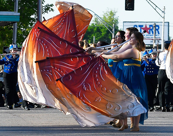Members of the Enid High School flag corp perform as they march in the 85th Tri-State Music Festival Parade Friday May 5, 2017 in downtown Enid. (Billy Hefton / Enid News & Eagle)
