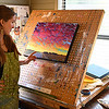 Catherine Freshley talks about one of her paintings in her studio May 25, 2017. (Billy Hefton / Enid News & Eagle)