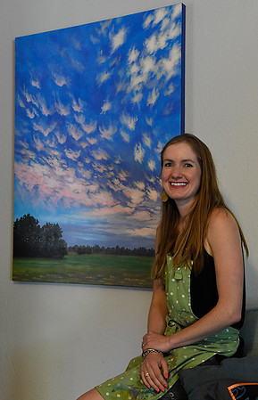 Catherine Freshley with one of her paintings May 25, 2017. (Billy Hefton / Enid News & Eagle)