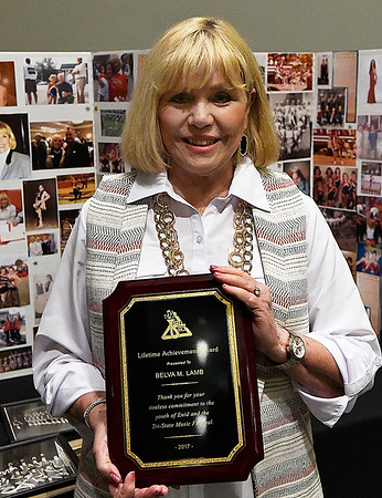 Belva Lamb hold a Lifetime Achievement Award plaque that she was given by the Tri-State Music Festival Friday May 5, 2017 during the Grand Concert a the Central National Bank Center. (Billy Hefton / Enid News & Eagle)