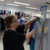 Janice Rockholt sorts through clothing to be stocked on racks at the Salvation Army Thrift Store Tuesday May 30, 2017. (Billy Hefton / Enid News & Eagle)