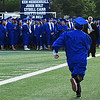 A late arriving member of the Enid HIgh School Class of 2017 runs to join classmates prior to the start of commencement exercies Thursday May 25, 2017 at D. Bruce Selby Stadium. (Billy Hefton / Enid News & Eagle)