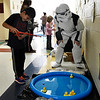 A stormtrooper helps Cruz Flores with a game during Family Fun Night at Monroe Elementary Thursday May 4, 2017. (Billy Hefton / Enid News & Eagle)