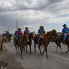 Members of the Wildhorse Gang ride down 30th street Wednesday May 31, 2017 on their way to the Cherokee Strip Regional Heritage Center commemorating the 150th anniversary of the Chisholm Trail. (Billy Hefton / Enid News & Eagle)