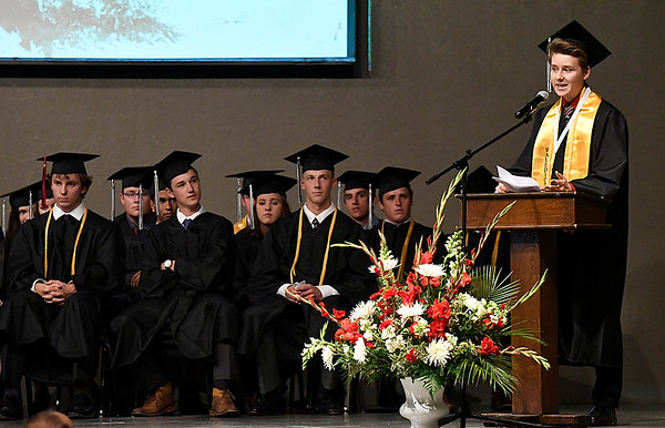 Cole Davis gives his valedictorian address during commencement exercises at Oklahoma Bible Academy Friday May 26, 2017. (Billy Hefton / Enid News & Eagle)