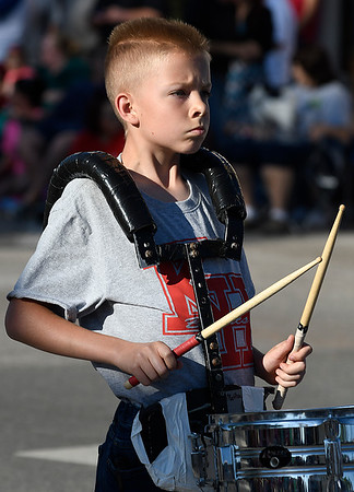A member of the Kremlin-Hillsdale grade school band drumline marches in the 85th Tri-State Music Festival Parade Friday May 5, 2017 in downtown Enid. (Billy Hefton / Enid News & Eagle)