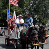 Awagon full of Wildhorse Gang members arrive at the Cherokee Strip Regional Heritage Center Wednesday May 31, 2017 commemorating the 150th anniversary of the Chisholm Trail. (Billy Hefton / Enid News & Eagle)