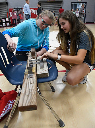 Ashlin Asay and Gracie Holder demonstrate their telegraph during Innovation Week at Chisholm Meddle School. (Billy Hefton / Enid News & Eagle)