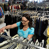 Teri Sigler stocks clothing on racks at the Salvation Army Thrift Store Tuesday May 30, 2017. (Billy Hefton / Enid News & Eagle)