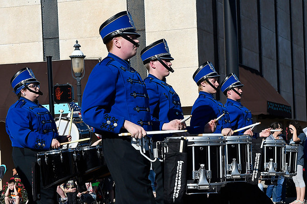 Members of the Enid High School drumline march in the 85th Tri-State Music Festival Parade Friday May 5, 2017 in downtown Enid. (Billy Hefton / Enid News & Eagle)