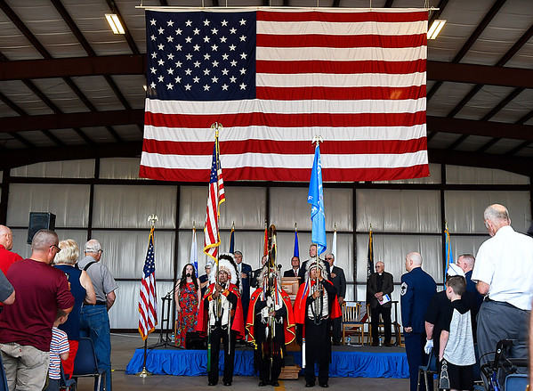 Members of the Kiowa Black Leggins Honor Society present the colors for the national anthem during Memorial Day Services at the Woodring Wall of Honor and Veterans Park Monday May 28, 2018. (Billy Hefton / Enid News & Eagle)