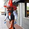 Oklahoma State mascot, Pistol Pete, walks away from the concession window during the Cowboy Caravan stop at David Allen Memorial Ballpark Monday May 14, 2018. (Billy Hefton / Enid News & Eagle)