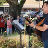 Sean Gallagher performs during the National Day of Prayer sponsored by the Enid Ministerial Alliance Thursday May 3, 2018 at the gazebo on the Garfield County Courthouse lawn. (Billy Hefton / Enid News & Eagle)