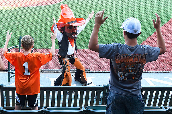 Oklahoma State mascot, Pistol Pete, lead fans in an OSU during the Cowboy Caravan stop at David Allen Memorial Ballpark Monday May 14, 2018. (Billy Hefton / Enid News & Eagle)