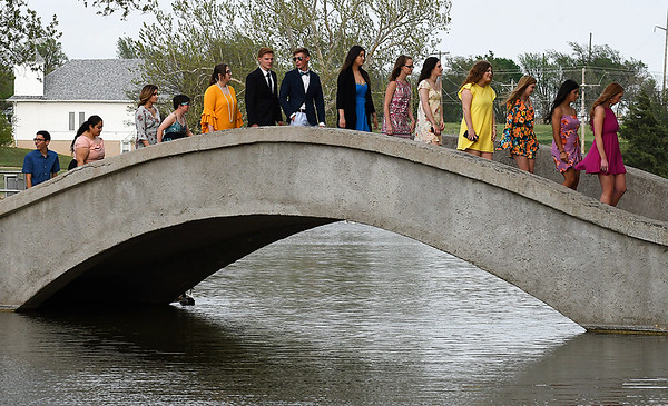 Members of the Enid High School senior class of 2018 cross the bridge at Government Springs Park during the 103rd May Fete Tuesday May 1, 2018. (Billy Hefton / Enid News & Eagle)