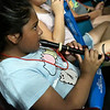 Audrielle Castro plays her recorder during a Link Up concert with the Enid Symphony Orchestra Monday May 14, 2018 at the Enid High Auditorium. (Billy Hefton / Enid News & Eagle)