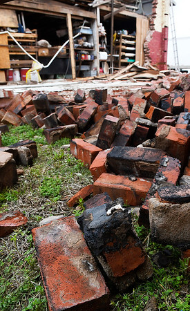 Charred brick from a wall of a garage/workshop in Jet that was struck by lightning Tuesday night. Free bricks are being offered to anyone who come and picks them up. (Billy Hefton / Enid News & Eagle)