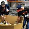 Silvia Garcia and Ron Gose sort donated food itens at Loaves & Fishes Monday May 13, 2019. (Billy Hefton / Enid News & Eagle)