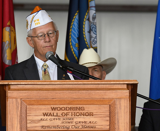 Enid mayor Major George Pankonin, USAF Retired welcomes those attending the Memorial Day services at the Woodring Wall of Honor and Veterans Park Monday May 27, 2019. (Billy Hefton / Enid News & Eagle)