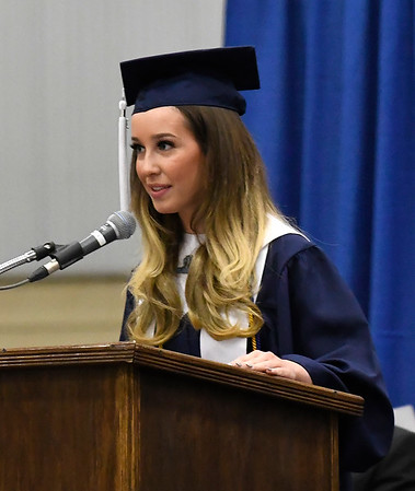 Enid High School senior class president, Brigitte Goulart, , welcomes those attending commencement exercises Thursday May 23, 2019 at the Chisholm Trail Expo Center. (Billy Hefton / Enid News & Eagle)