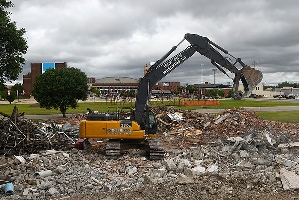 A tract hoe demolishes a building on west Park Thursday May 9, 2019. (Billy Hefton / Enid News & Eagle)