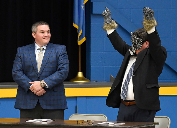 B.B. Wolf (Dr. Darrell Floyd) raises his arms in victory as his attorney, Clint Clayole stands by after Wolf was found not guilty during a mock trail at Monroe Elementary Thursday May 2, 2019. (Billy Hefton / Enid news & Eagle)