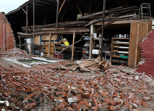 The wall of a garage/workshop in Jet collapsed after it was struck by lightning Tuesday night. Free bricks are being offered to anyone who comes to pick them up. (Billy Hefton / Enid News & Eagle)