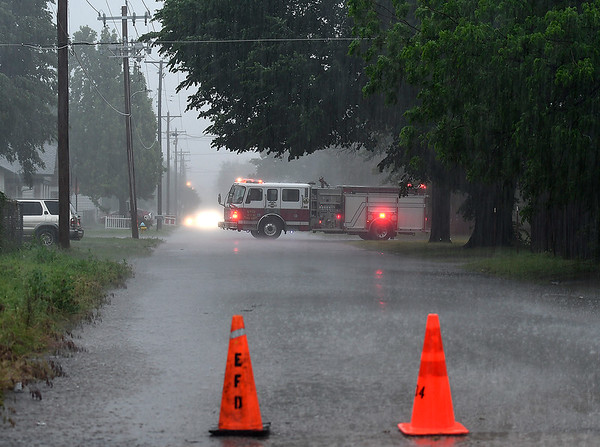 A unit of the Enid Fire Department blocks north Chestnut after a powerline was knocked down Monday May 20, 2019. (Billy Hefton / Enid News & Eagle)
