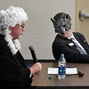 B.B. Wolf (Dr. Darrell Floyd) leans in to hear Judge Jack Hammontree during a mock trail at Monroe Elementary Thursday May 2, 2019. (Billy Hefton / Enid news & Eagle)