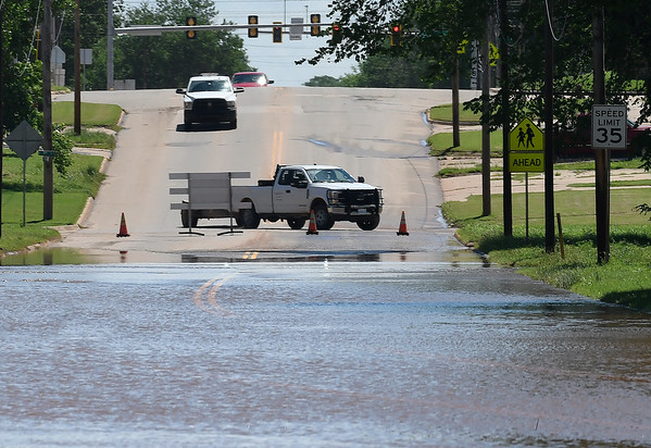 Traffic turns to avoid th eflood water across Highway on the west side of Kingfisher Tuesday May 21, 2019. (Billy Hefton / Enid News & Eagle)
