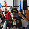 A veteran salutes the American flag during the playing of the national anthem during Memorial Day services at the Woodring Wall of Honor and Veterans Park Monday May 27, 2019. (Billy Hefton / Enid News & Eagle)