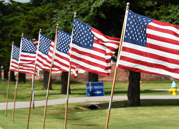 American flags line the street during Memorial Day services at the Woodring Wall of Honor and Veterans Park Monday May 27, 2019. (Billy Hefton / Enid News & Eagle)