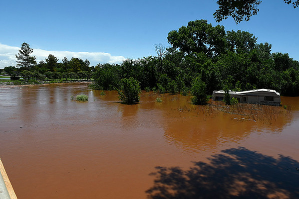 Uncle John Creek overflowing it's banks in Kingfisher Tuesday May 21, 2019. (Billy Hefton / Enid News & Eagle)