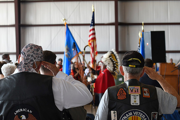 Veterans salute the American flag during the playing of the national anthem during Memorial Day services at the Woodring Wall of Honor and Veterans Park Monday May 27, 2019. (Billy Hefton / Enid News & Eagle)