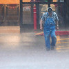 A man walks through the Jumbos West parking lot during a heavy rain storm Monday May 20, 2019. (Billy Hefton / Enid News & Eagle)