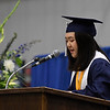 Enid High School valedictorian, Grace Minji Kim, addresses those attending commencement exercises Thursday May 23, 2019 at the Chisholm Trail Expo Center. (Billy Hefton / Enid News & Eagle)