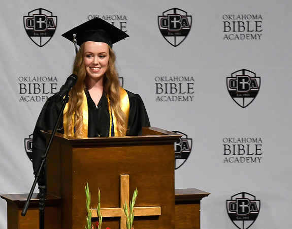 Ashlyn Beagley speaks on the school mission during the Oklahoma Bible Academy commencement exercises Friday May 24, 2019. (Billy Hefton / Enid News & Eagle)