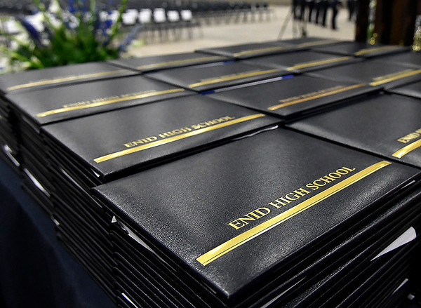 Diplomas await graduating senior prior to commencement exercises Thursday May 23, 2019 at the Chisholm Trail Expo Center. (Billy Hefton / Enid News & Eagle)