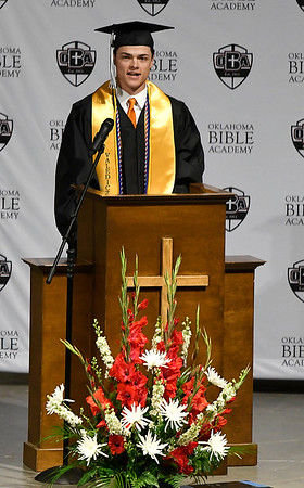 Traber Smithson welcomes those attending the Oklahoma Bible Academy commencement exercises Friday May 24, 2019. (Billy Hefton / Enid News & Eagle)