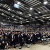 Enid High School senior throw their caps into the air following commencement exercises Thursday May 23, 2019 at the Chisholm Trail Expo Center. (Billy Hefton / Enid News & Eagle)